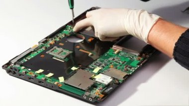 Notebook motherboard mounting during service repairing — Stock Video