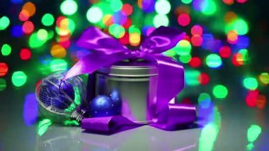 Christmas decorations composition with fancy box on blinking bokeh background — Stock Video