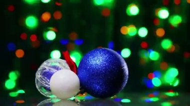 New Year decoration ball toys rotating on blinking bokeh background — Stock Video