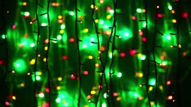 New Year illumination garland decoration blinking on bokeh background — Stock Video