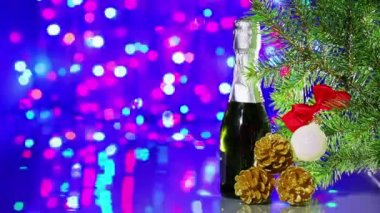 Christmas tree decorations with spruce and champagne on bokeh background — Stock Video