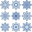 Set of 9 decorative elements or snowflakes — Stock Vector #46321995