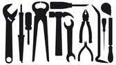 Set of silhouettes of tools — Stock Vector