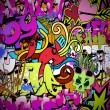 Graffiti wall art background. Hip-hop style seamless texture pat — Stock Vector #21389875