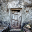 Grunge old door background texture on vintage retro building wal — Stock Photo