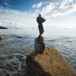 Zen rock tower on sea cost morning sunrise time — Stock Photo