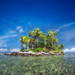Tropical island with green plants in clear sea water — Stock Photo