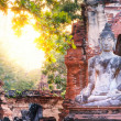Stock Photo: Buddha and sun light at Wat Mahathat, Ayutthaya, Thailand. Ancie