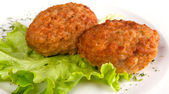 Cutlets and salad on a plate — Stock Photo