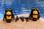 Aqualung and flippers near the pool — Stock Photo