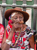 Old lady with cigar — Stock Photo