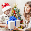 Mother and son with new year present or christmas holiday gift b — Stok fotoğraf