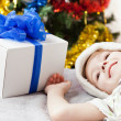 Royalty-Free Stock Photo: Smiling child boy with new year present or christmas holiday gif