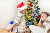 Mother and son with new year present or christmas holiday gift b — Stock Photo