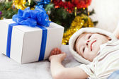 Smiling child boy with new year present or christmas holiday gif — Stock Photo