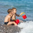 Children on sea beach — Stock Photo #13632020