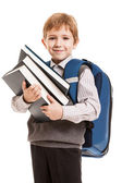 Schoolboy with backpack holding books — Stock Photo