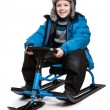 Child on snow scooter or snowmobile toy — Stock Photo