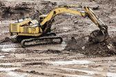 Digging excavator machine at building construction site — Stock Photo