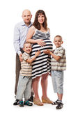 Two little sons with father and pregnant mother — Stock Photo