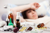 Unwell woman patient lying down bed — Stock Photo