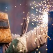Arc welder worker in protective mask welding metal construction — Stock Photo