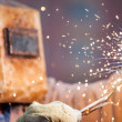 Stock Photo: Arc welder worker in protective mask welding metal construction