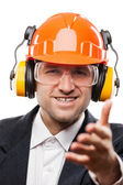 Businessman in safety hardhat helmet gesturing hand greeting or — Stock Photo