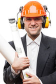 Businessman in safety hardhat helmet holding paper drawings plan — Stock Photo
