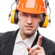 Businessman in safety hardhat helmet gesturing exclamation point — Stock Photo