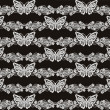 Butterfly and floral white lace seamless pattern on black background — Stock Photo #38199713