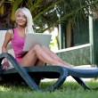 Young woman on lounge with laptop — Stock Photo #28865919