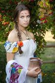 Beautiful ukrainian girl in traditional dress — Stock Photo