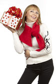 Woman holding giving a gift — Stock Photo