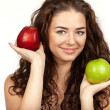 Beautiful brunette holding apples — Stock Photo