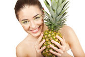 Young beautiful woman holding pineapple — Stock Photo