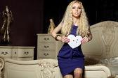 Young beautiful woman holding broken paper heart — Stock Photo