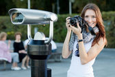 Young woman tourist standing near by the telescope — Stock Photo