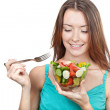 Woman holding plate of fresh vegetables — Stock Photo
