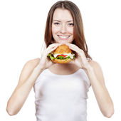 Beautiful young woman holding hamburger — Stock Photo