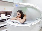 Young beautiful woman at steam SPA capsule — Stock Photo