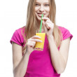 Young beautiful blond woman drinking orange juice — Stock Photo #30500953