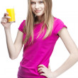 Young beautiful blond woman drinking orange juice — Stock Photo