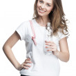 Young woman holding glass of water — Stock Photo