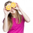 Young beautiful blond woman holding orange — Stock Photo