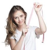 Unga vackra brunett kvinna med mätare — Stockfoto
