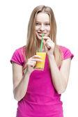 Young beautiful blond woman drinking orange juice — Stock Photo
