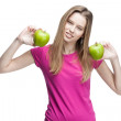 Young woman holding two green apples — Stock Photo