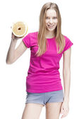 Young beautiful blond woman holding pomelo — Stock Photo