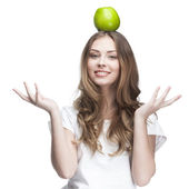 Young beautiful brunette woman with green apple — Stock Photo